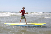 Youths Catch Waves At Surf Camp For Those With Autism
